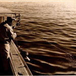 Edgar Post hauling a trap with wooden buoy. 1960s